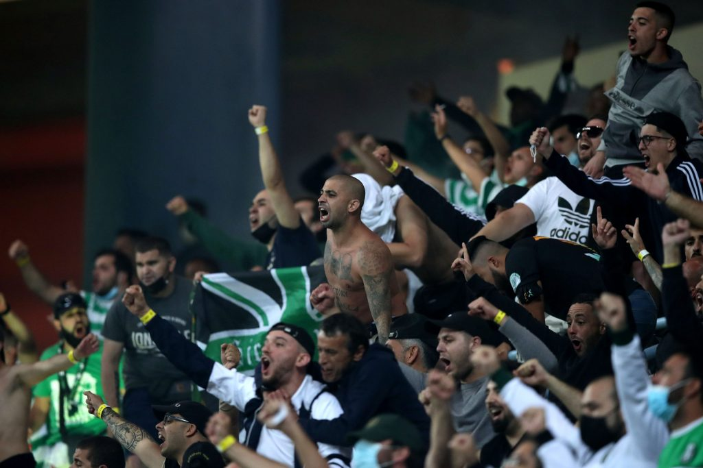 Sporting's supporters celebrate after a goal against Sporting de Braga during the Portuguese Candido de Oliveira Supercup soccer match, held at Aveiro Municipal Stadium, Portugal, 31 July 2021. ESTELA SILVA/LUSA
